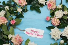 Mothers day card and  beautiful roses on blue wooden background Stock Image