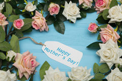 Mothers day card and  beautiful roses on blue wooden background Royalty Free Stock Image