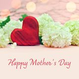 Mothers Day card with heart and flowers. Mothers Day card with red heart and snowball flowers royalty free stock photos