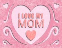 Mothers day Card Paper cut out I Love My Mom. The perfect card to say I love you. Pink textured background. Heart cut outs and swirls Stock Photography