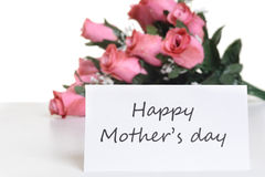 Mothers day card. With pink roses in the background Stock Photos