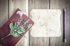Mothers day card with red book on wooden board Royalty Free Stock Image