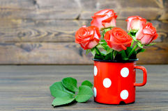 Mothers Day card with red roses in old cup Royalty Free Stock Photos