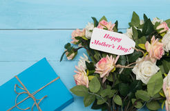 Mothers day card and  roses on blue background with gift Stock Photography