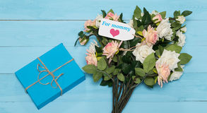 Mothers day card and  roses on blue background with gift Royalty Free Stock Image