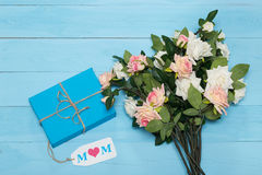 Mothers day card and  roses on blue background with gift Stock Photo