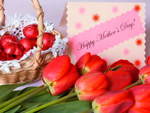 Mothers Day Card - Stock Photos. Mothers Day Card with Happy Mother's Day text , red tulips and chocolates Royalty Free Stock Photo