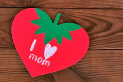 Mothers day card on wooden table. Children's crafts, greeting card I love mom. Paper strawberry. Original card Stock Image