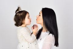 Mothers day. Childrens day. Beauty and fashion. Happy woman with little girl. Mother and daughter. Love and family. they stock photo