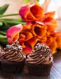 Mothers day  chocolate cupcakes  with spring tulips Royalty Free Stock Photo