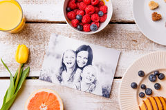 Mothers day composition. Black-and-white picture and breakfast m Stock Photography