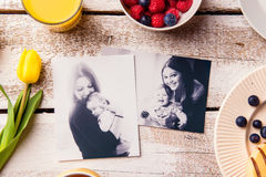 Mothers day composition. Black-and-white pictures and breakfast. Mothers day composition. Black-and-white pictures of mother holding her little baby daughter and royalty free stock image