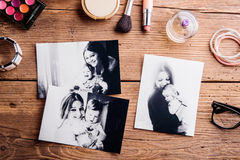 Mothers day composition. Black-and-white pictures and make up pr. Mothers day composition. Black-and-white pictures of mother holding her little baby and various royalty free stock photography