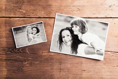 Mothers day composition. Black-and-white pictures, wooden background. Mothers day composition. Various black-and-white family pictures. Studio shot on wooden royalty free stock photo