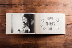 Mothers day composition. Photo album, black-and-white picture. W. Mothers day composition. Photo album, black-and-white picture. Studio shot on wooden background Stock Photography