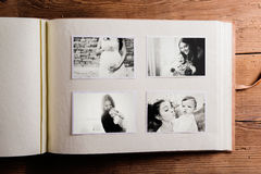 Mothers day composition. Photo album, black-and-white pictures. Studio shot on wooden background Royalty Free Stock Images