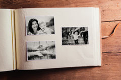 Mothers day composition. Photo album, black-and-white pictures. Studio shot on wooden background Stock Images
