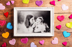 Mothers day composition, picture frame. Studio shot, wooden, bac Royalty Free Stock Photo