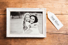 Mothers day composition. Picture frame. Wooden background. Studi Stock Image
