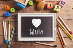 Mothers day composition, various toys. Picture frame, studio sho Royalty Free Stock Photography