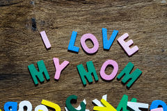Mothers day concept - I Love My Mom texts. On Wooden Background Stock Images