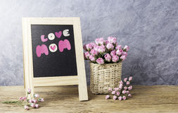 Mothers day concept of paper pink rose flowers with love mom Royalty Free Stock Images