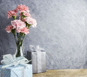 Mothers day concept of pink carnation flowers in clear bottle royalty free stock image