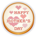 Mothers Day Cross Stitch Embroidery, wood hoop. Retro wood embroidery hoop with needlework sewing design, Happy Mothers Day with big red and pink hearts in cross Royalty Free Stock Image