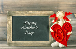 Mothers Day! decoration. Funny girl with Red Heart and blackboar Stock Images