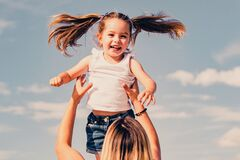 Free Mothers Day. Excited Girl. Happy Mother And Daughter Over Blue Sky Background. Mother And Daughter Spending Time Royalty Free Stock Image - 200554056