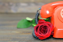 Mothers Day flower: Red rose and vintage telephone Stock Photo
