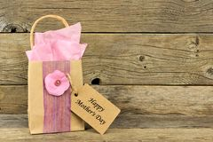 Mothers Day gift bag with tag against rustic wood Stock Photography