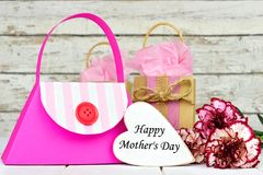 Mothers Day gift bags with heart tag and flowers Royalty Free Stock Image