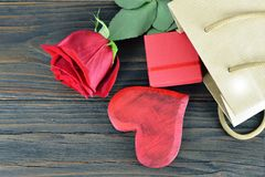 Mothers Day gift box, heart and rose. Mothers Day gift box, heart and red rose Stock Photography