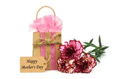 Mothers Day gift with heart tag and flowers over white Royalty Free Stock Image