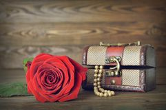 Mothers Day gift and red rose Royalty Free Stock Image