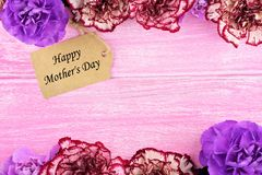 Mothers Day gift tag with flower frame on pink wood Royalty Free Stock Photo
