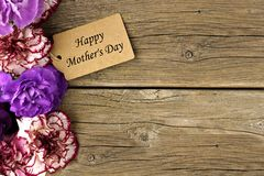 Mothers Day gift tag with flower side border on wood Royalty Free Stock Photo