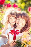 Mothers day. Happy women and child with beautiful spring flowers against green background. Family holiday concept. Mothers day Stock Photos