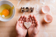 Mothers day. Heart cookie, baking, cookie cutters. Wooden backgr Royalty Free Stock Image
