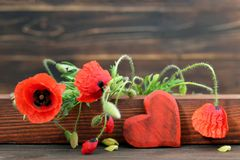 Mothers Day heart and poppies. Mothers Day heart and red poppies stock photography