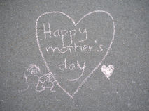 Mothers day - heart shape chalk drawing on the ground. Mothers day - heart shape and mother and child chalk drawing on the ground stock photo