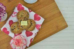Mothers day homemade cookies and flowers with a thanks mum note stock photos