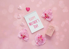 Mothers Day message with gift box, orchid flowers and hearts on Royalty Free Stock Photo