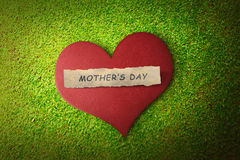Mothers day message on paper in red heart Stock Photography