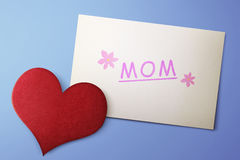 Mothers Day message on paper with red hearts Stock Images