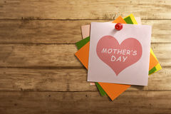 Mothers Day message written on stack of colorful paper note Stock Photography