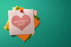 Mothers Day message written on stack of colorful paper note Royalty Free Stock Image