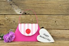 Mothers Day purse gift bag with heart tag on wood Stock Image