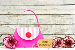 Mothers Day purse gift bag with tag and flowers Stock Photo